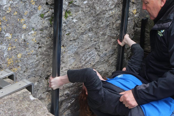 Anabelle Fletcher, a sophomore at Wylie High School, kisses the Blarney Stone.