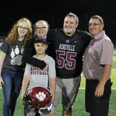 Lance Abernathy, far right, has resigned as Asheville High's athletic director