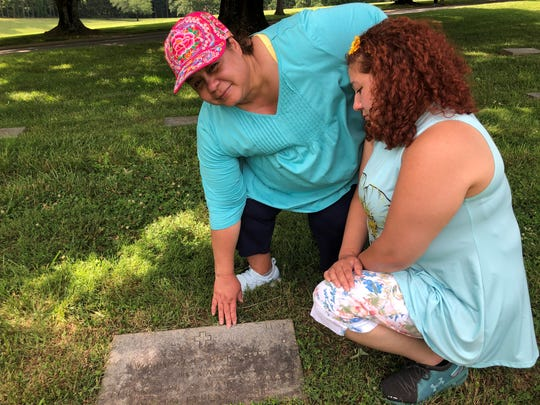 Mary Norausky, left, and her daughter Natasha Norausky visit the grave site of Wallace Burnette on Father's Day weekend.