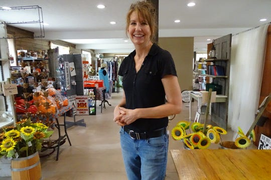 Co-owner Laura Stuckey shows off The Stalls at Pickwick Place, which opened Friday.