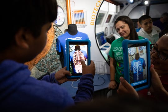 Robstown ISD students use a station on the Texas Alliance for Minorities in Engineering's museum-on-wheels on Tuesday, June 18, 2019.