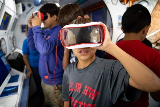 Robstown ISD students take a virtual space walk on the Texas Alliance for Minorities in Engineering's museum-on-wheels on Tuesday, June 18, 2019.
