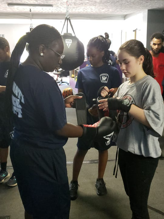 Members of the Cincinnati Police Cadet Academy work out at Carradine Youth Boxing Academy, 2739 W. McMicken Ave. on Friday, June 14, 2019.