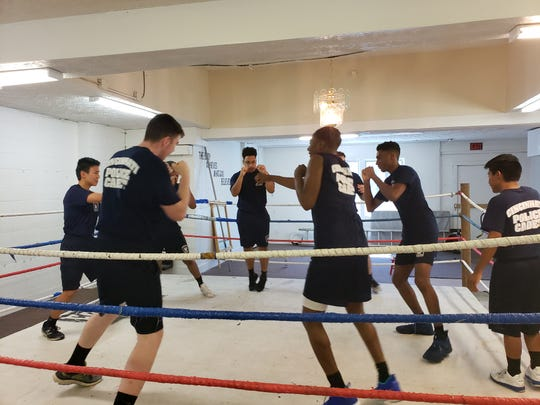Members of the Cincinnati Police Cadet Academy work out at Carradine Youth Boxing Academy on Friday, June 14, 2019.