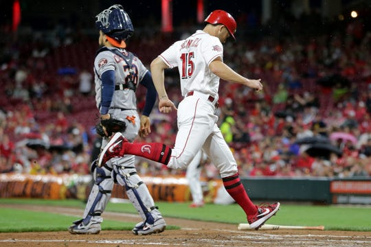 Cincinnati Reds third baseman Nick Senzel (15) scores on a single by Cincinnati Reds third baseman Eugenio Suarez (7) (not pictured) in the fifth inning of an MLB baseball game against the Houston Astros, Monday, June 17, 2019, at Great American Ball Park in Cincinnati.