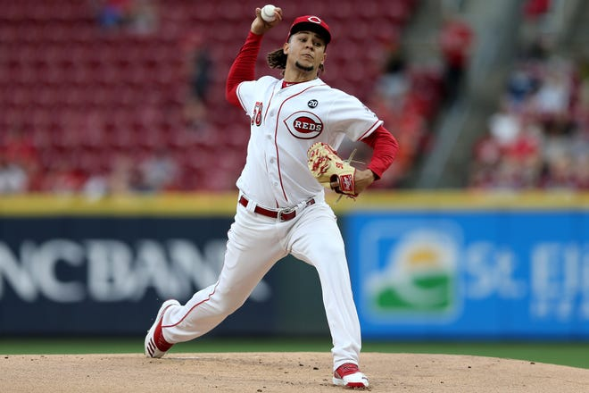 Cincinnati Reds starting pitcher Luis Castillo (58) delivers in the first inning of an MLB baseball game against the Houston Astros, Monday, June 17, 2019, at Great American Ball Park in Cincinnati.