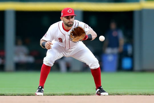Cincinnati Reds second baseman Jose Peraza (9) fields a groundball in the first inning of an MLB baseball game against the Houston Astros, Monday, June 17, 2019, at Great American Ball Park in Cincinnati.