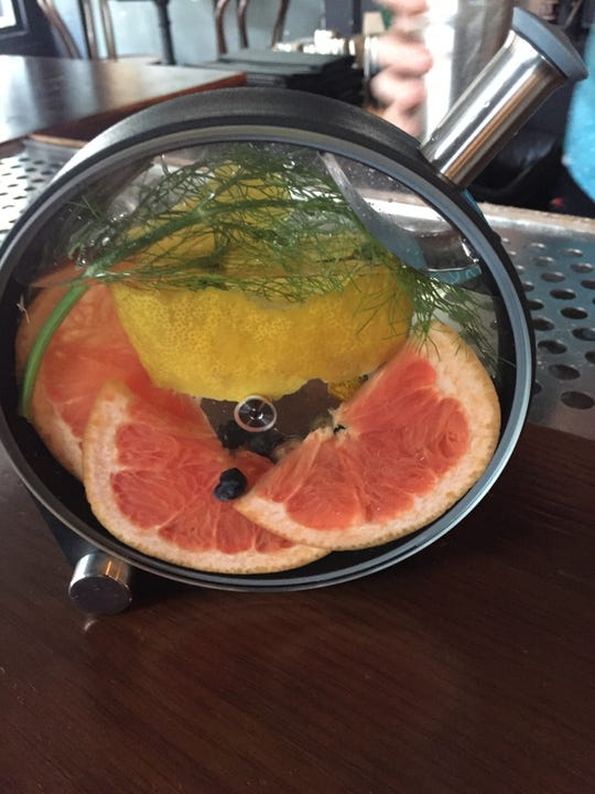 The Slow Play, a cocktail made in a porthole infuser at Comfort Station