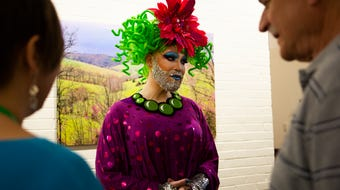Drag queen Sparkle reads to the congregation at the Mt. Auburn Presbyterian Church during pride month.