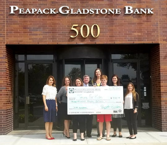 Peapack-Gladstone Bank has presented a donation of $3,030 to Teams for Kids Foundation, made on behalf of its employees, clients and friends.  Leonardo Scotti, Long Valley resident and student at Seton Hall Preparatory School, accepted the donation at the Bank's Bedminster Headquarters to support the organization's efforts in providing the necessary funding to allow children from homeless and low-income families within the State of New Jersey to participate in sports programs.