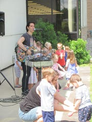 "Last year's ""Kick Off to Summer Reading"" party, featuring music and other activities."