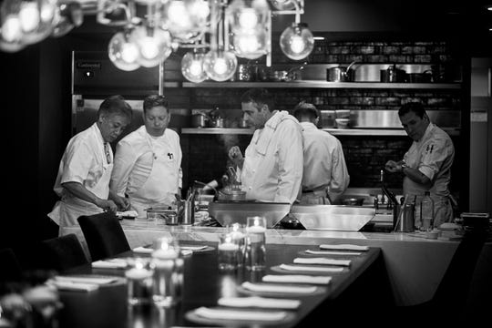 From left: Pernoi Executive Chef Takashi Yagihashi, Chef de Cuisine Justin Fulton and Executive Chef Luciano DelSignore in the kitchen of Chef's Table at the Detroit Foundation Hotel as they prep a dinner previewing their upcoming Birmingham restaurant on June 12, 2019.