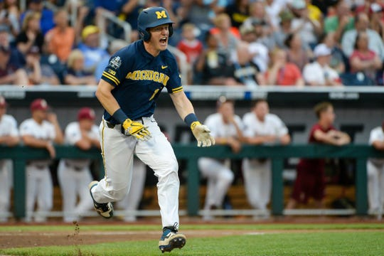 Michigan first baseman Jimmy Kerr celebrates after driving in a run in the fifth inning against Florida State in the 2019 College World Series in Omaha, Neb., Monday, June 17, 2019.
