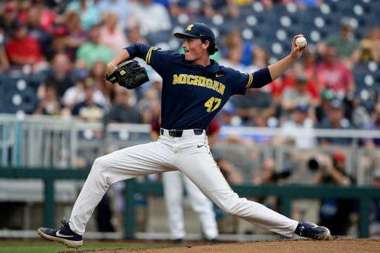 Michigan pitcher Tommy Henry delivers against Florida State in the first inning of an NCAA College World Series baseball game in Omaha, Neb., Monday, June 17, 2019.