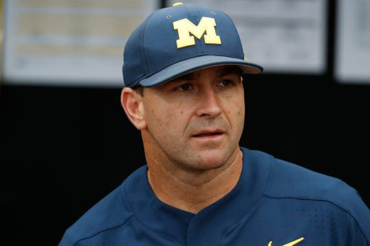 Michigan head coach Erik Bakich looks in the dugout prior to the game against Florida State in the 2019 College World Series in Omaha, Neb., Monday, June 17, 2019.