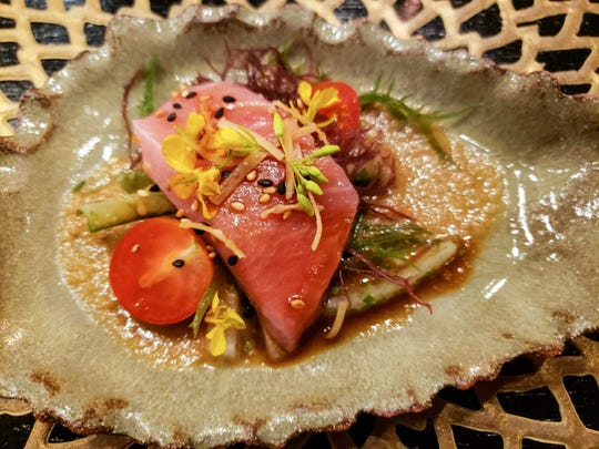 Bluefin toro with spring onion vinaigrette from the Pernoi preview pop-up dinner at the Chef's Table at the Detroit Foundation Hotel. Pernoi, helmed by veteran chefs Luciano DelSignore and Takashi Yagihashi, is slated to open in Birmingham later this summer.