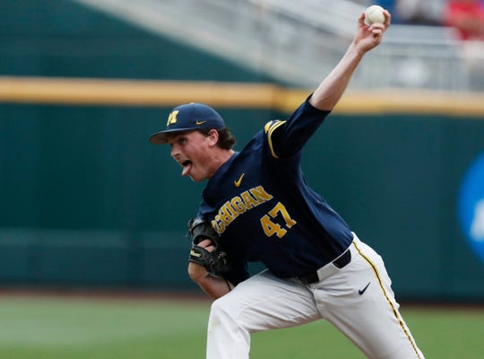 Michigan pitcher Tommy Henry throws in the first inning against Florida State in the 2019 College World Series in Omaha, Neb., Monday, June 17, 2019.