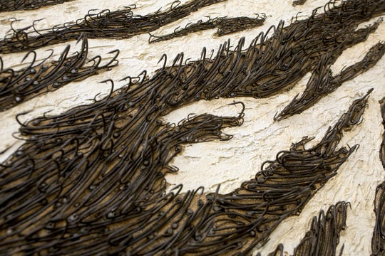"""Yoan Capote's """"Island (see-escape)"""" is shown at Cranbrook Art Museum in Bloomfield Hills, Mich., Monday, June 17, 2019."""