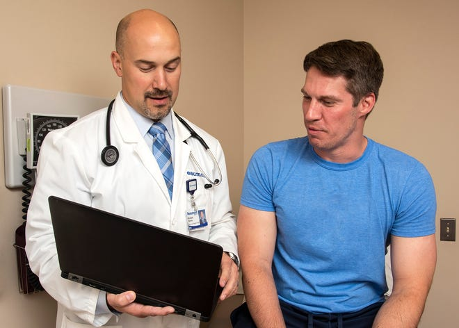 Richard Grucz, MD, with patient Anthony Marijanovich, of South Lyon, at the Beaumont Medical Center, Canton.