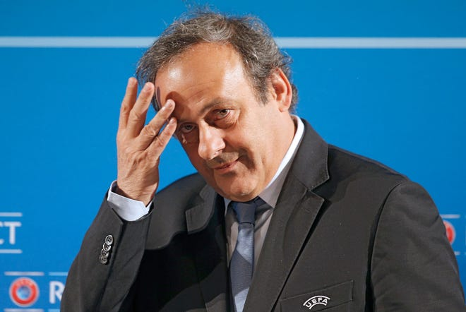 French police investigating whether corruption played a role in the stunning decision to award the 2022 World Cup to the desert nation of Qatar took former soccer superstar and top executive Michel Platini into custody Tuesday for questioning.