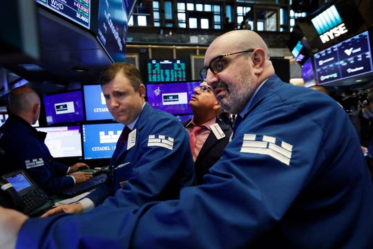 Specialists Thomas Schreck, left, and Peter Giacchi, right, work on the floor of the New York Stock Exchange, Tuesday, June 18, 2019.