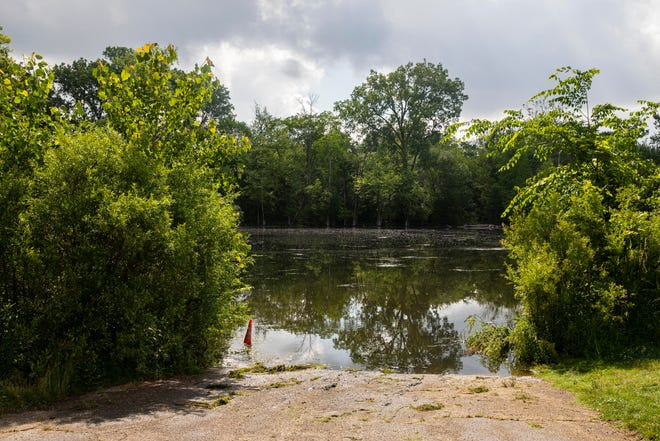 The spot on the Kalamazoo River near Verburg Park where police found the bodies of a mother and two children and a submerged vehicle, in Kalamazoo.