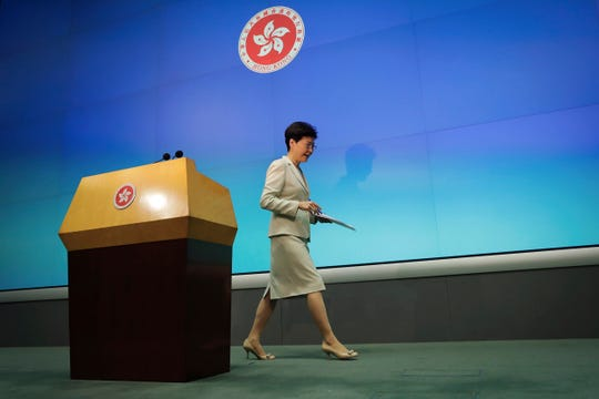Hong Kong Chief Executive Carrie Lam leaves after a press conference at the Legislative Council in Hong Kong, Tuesday, June 18, 2019. Lam apologized Tuesday for an unpopular extradition bill that drew massive protests and indicated that it will not be revived during the current legislative session.