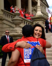 Michigan Governor Gretchen Whitmer hugs a rally goer Tuesday, June 18, 2019.