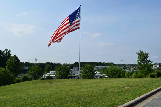 An American flag at Gander RV, in Statesville, North Carolina. The city has voted against the flying of really big flags, holding its ground against reality TV star Marcus Lemonis' huge Stars and Stripes.