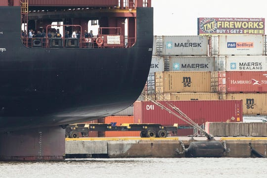 Officials gather on the decks of the MSC Gayane container ship on the Delaware River in Philadelphia, Tuesday, June 18, 2019. U.S. authorities have seized more than $1 billion worth of cocaine from a ship at a Philadelphia port, calling it one of the largest drug busts in American history.