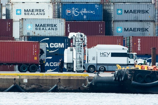 Authorities search a container along the Delaware River in Philadelphia, Tuesday, June 18, 2019. U.S. authorities have seized more than $1 billion worth of cocaine from a ship at a Philadelphia port, calling it one of the largest drug busts in American history.