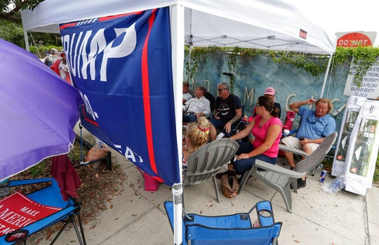 Supporters of President Donald Trump, some that lined up in the early hours Monday, June 17, 2019, in Orlando, Fla, wait more than 24 hours before the doors to the Amway Center open for a rally.