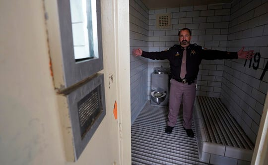 "Dane County, Wis., Sheriff David Mahoney stands in a solitary confinement cell at the county jail. An advocate for the mentally ill, Mahoney says he sometimes has to lock certain inmates in these cells even though he calls the conditions ""inhumane."" Mahoney hopes to secure funding to replace the jail with one that will have a hospital-like wing."