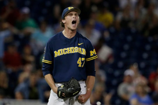 Michigan pitcher Tommy Henry (47) reacts after finishing off his complete-game gem against Florida State in the College World Series.