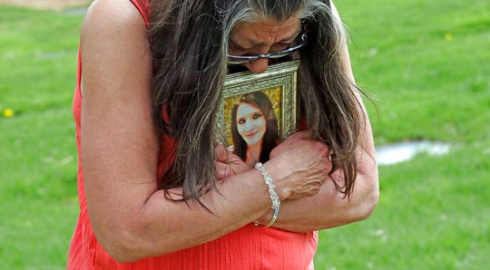 Melany Zoumadakis clutches a photo of her daughter, Tanna Jo Fillmore, on Friday, April 26, 2019, in Salt Lake City. Fillmore killed herself in the Duchesne County Jail in 2016, after repeatedly calling her mother, saying she was being denied her prescription medicines that had stabilized her. Her mother has filed suit.