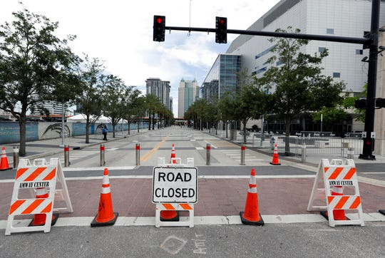 Road closures are seen around the Amway Center, right, on Monday, June 17, 2019 the site of a Tuesday night rally for President Donald Trump, in Orlando, Fla.