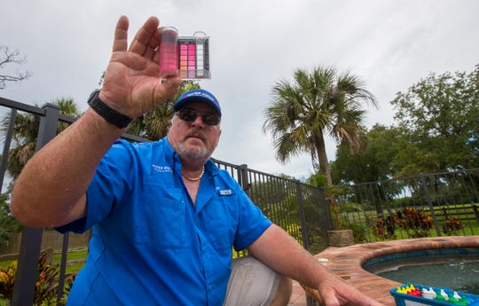 Rod Siliski, 52, tests the water on a residential pool in Alva, Tuesday, June 18, 2019. Siliski, a senior pool technician with Water Medic of Cape Coral, was selected as the Florida Swimming Pool AssociationÕs Service Pro of the Year for 2018 during a ceremony this past February in Orlando, FL.
