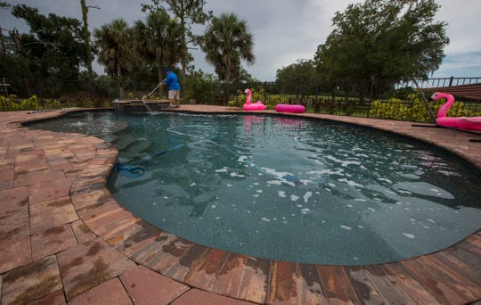 Rod Siliski, 52, brushes the sides of a residential pool in Alva, Tuesday, June 18, 2019. Siliski, a senior pool technician with Water Medic of Cape Coral, was selected as the Florida Swimming Pool AssociationÕs Service Pro of the Year for 2018 during a ceremony this past February in Orlando, FL.