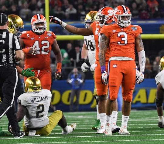 Clemson defensive lineman Xavier Thomas (3) reacts after tackling Notre Dame running back Dexter Williams (2) during the second quarter of the College Football Playoff Semifinal at the Goodyear Cotton Bowl Classic at AT&T Stadium in Arlington, Texas Saturday, December 29, 2018.