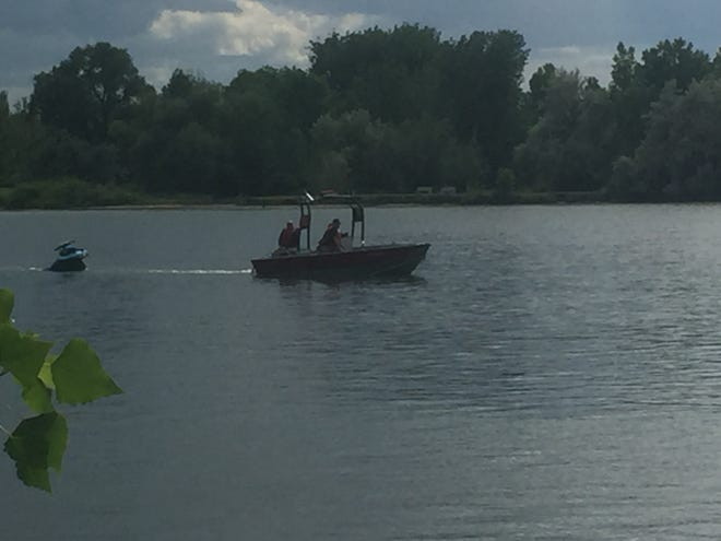 Great Falls Fire and Rescue personnel tow a jet ski to shore Tuesday afternoon near Broadwater Bay in Great Falls.