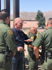 Attorney General Tim Fox talks with U.S. Customs and Border Protection officers
