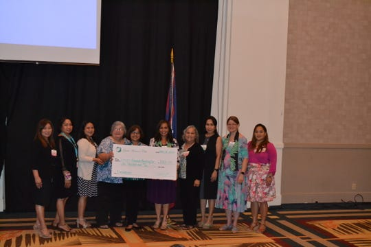 Guam Women's Club Board presented $1000 to VARO on May 31. From left: Leo Jordanou, immediate past president; Maricor Gerstenlauer, member at large; Joiz Salas, recording secretary; Gloria Borja, VARO; Judith Won Pat, VARO; Caroline H. Sablan, president; Loling Field, treasurer; Cari Nakagawa, corresponding secretary; Mary Lou Wheeler, vice president; Angie Gibbons, member at large.