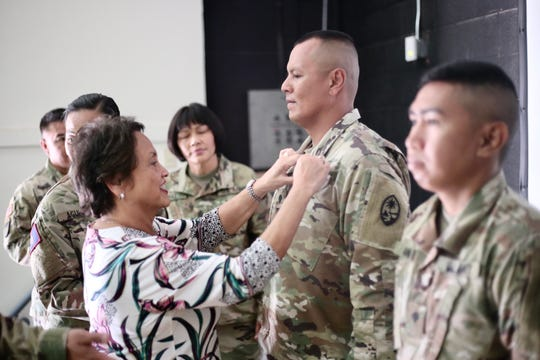 Gov. Lou Leon Guerrero pins Sgt. Manny Acfalle of CCO an Army Achievement Medal during a ceremony in Fort Bliss.