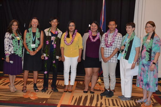 Guam Women's Club presented $1,000 scholarships to four students attending Guam Community College at their general membership meeting held on May 31 at the Sheraton Laguna Resort. Pictured with the GWC members are: Ruiqiang Yang, Aines Tolentino, Chauntae Quichocho and Kenly Magwili.