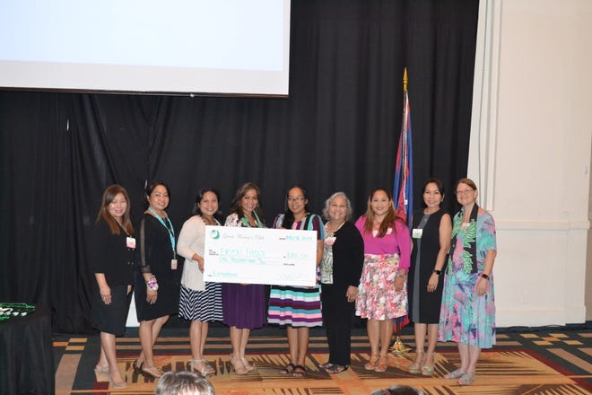 Guam Women's Club Board presented a check in the amount of $1000 to Erica's House on May 31. From left: Leo Jordanou, immediate past president; Maricor Gerstenlauer, member at large;  Joiz Salas, recording secretary; Caroline H. Sablan, president; Natalie DeLeon, Erica's House; Loling Field, treasurer; Angie Gibbons, member at Large; Cari Nakagawa, corresponding secretary; Mary Lou Wheeler, vice president.