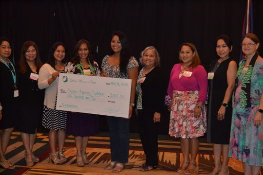 Guam Homeless Coalition was presented with a check in the amount of $1000 by the Guam Women's Club on May 31. From left:  Maricor Gerstenlauer, member at large; Leo Jordanou, immediate past president; Joiz Salas, recording secretary; Caroline H. Sablan, president; Angelina Cruz, Guam Homeless Coalition; Loling Field, treasurer; Angie Gibbons, member at large; Cari Nakagawa, corresponding secretary; Mary Lou Wheeler, vice president.