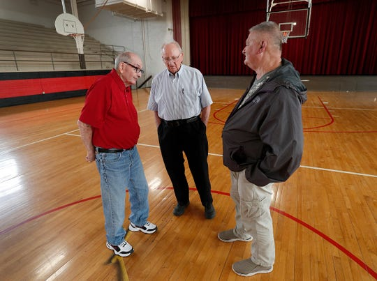 1954 Fillmore boys basketball team was undefeated going into the state tournament, and was two games short of meeting Milan at semi-state before they lost to Montezuma. Former Fillmore Cardinal players Dee Greenlee, left, Herschel Ross and Bob Sibbitt reminisce about that season in their historic gym.