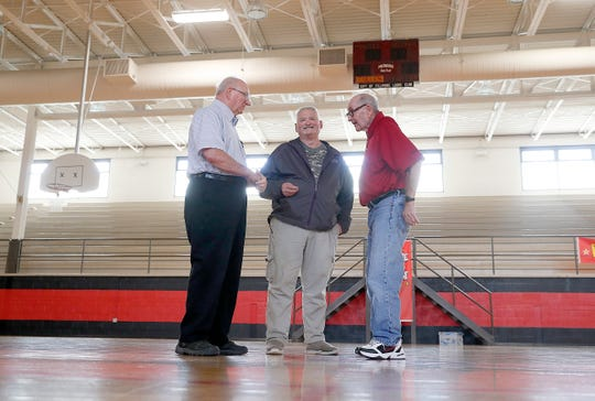 1954 Fillmore boys basketball team was undefeated going into the state tournament, and was two games short of meeting Milan at semi-state before they lost to Montezuma. Former Fillmore Cardinal players Herschel Ross, left, and Bob Sibbitt and Dee Greenlee, right, reminisce about that season in their historic gym.