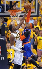 Roy Hibbert blocks a dunk attempt by Carmelo Anthony of the Knicks in the Eastern Conference semifinals in 2013.