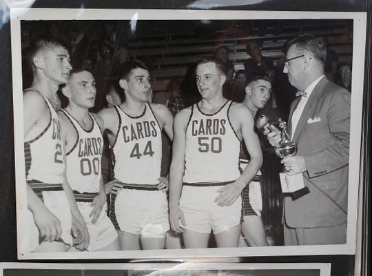 1954 Fillmore boys basketball team was undefeated going into the state tournament, and was two games short of meeting Milan at semi-state before they lost to Montezuma. Fillmore Cardinal players Bob Sibbitt (22), left, Dee Greenlee (00), Don Tharp (44) and Herschel Ross (50).